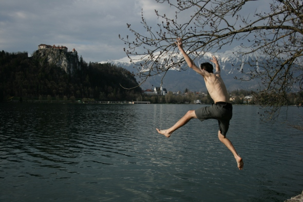 Rob leaping into Lake Bled, after a long day of cycling.
