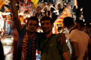 Rob with a Galatasaray supporter in Taksim Square.