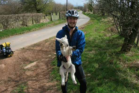Andrew helping a lamb with a gambolling problem